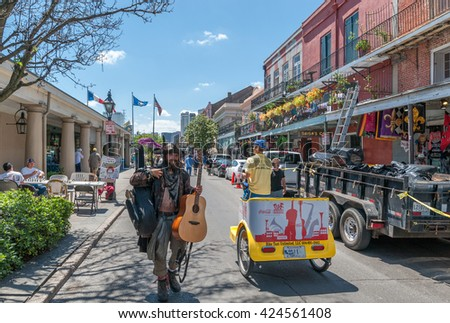 NEW ORLEANS, LOUISIANA - APRIL 10, 2016: Street Musician and French Quarter Music Festival in New Orleans. - stock photo