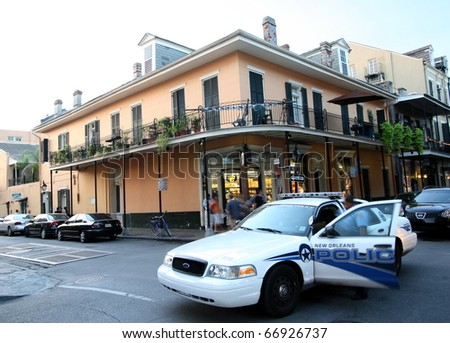 NEW ORLEANS, LOUISIANA - AUGUST 5: A police car in the French Quarter in New Orleans on August 5, 2010.  The city maintains a high police presence to protect the tourist industry, an income source. - stock photo