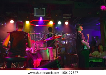 NEW ORLEANS, LOUISIANA - CIRCA 2004: Band preforms in a rock club in French Quarter at night in New Orleans, Louisiana