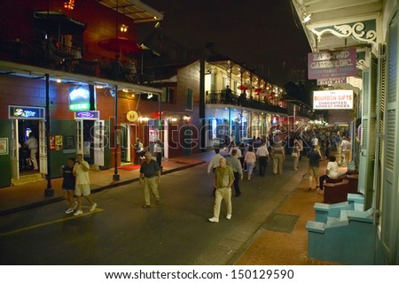 NEW ORLEANS, LOUISIANA - CIRCA 2004: Night life with lights on Bourbon Street in French Quarter New Orleans, Louisiana - stock photo