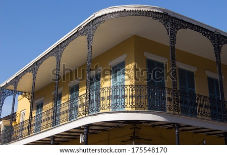 NEW ORLEANS, LOUISIANA- JANUARY 18, 2014:  French Quarter balcony during  Carnevale in preparation for Mardi Gras - stock photo