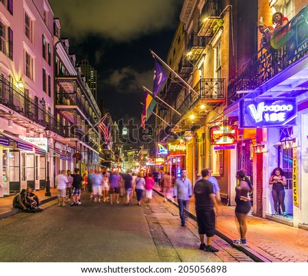 NEW ORLEANS, LOUISIANA - JULY 14, 2013: Neon lights in the French Quarter, New Orleans, USA. Tourism provides a much needed source of revenue after the 2005 devastation of Hurricane Katrina. - stock photo