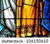 NEW ORLEANS, LOUISIANA-JUNE 15, 2012:  Stained glass window with religious motif at Saint Louis Cathedral in the New Orleans French Quarter on June 15, 2012. - stock photo