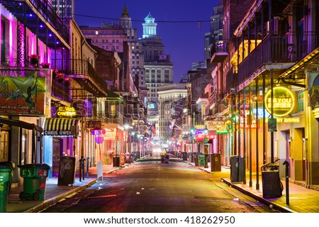 NEW ORLEANS, LOUISIANA - MAY 10, 2016: Bourbon Street in the early morning. The renown nightlife destination is in the heart of the French Quarter. - stock photo