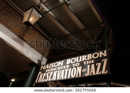 NEW ORLEANS, LOUISIANA, May 4, 2015 : Bourbon Street in the heart of New Orleans. Now mainly known for its bars and strip clubs, Bourbon Street's history provides a rich insight into New Orleans'past - stock photo