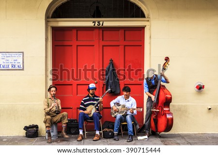 NEW ORLEANS, LOUISIANA USA- FEB 2 2016: An unidentified  local jazz band performs  in the New Orleans French Quarter, to the delight of visitors and music lovers  in town.  - stock photo
