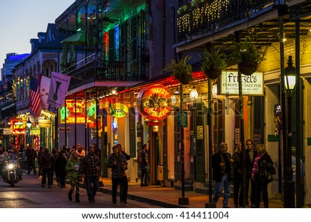 NEW ORLEANS, LOUISIANA USA- FEB 2 2016: Pubs and Bars having colorful lights and decorations in the French Quarter. Tourism provides a much needed financial source, also home for great musicians.  - stock photo