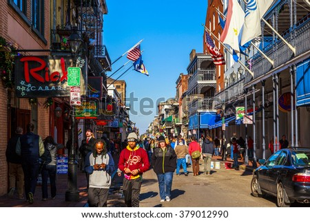 NEW ORLEANS, LOUISIANA USA - JAN 22 2016: Historic building in the French Quarter in New Orleans, USA. Tourism provides a large source of revenue, also home great many musicians.  - stock photo