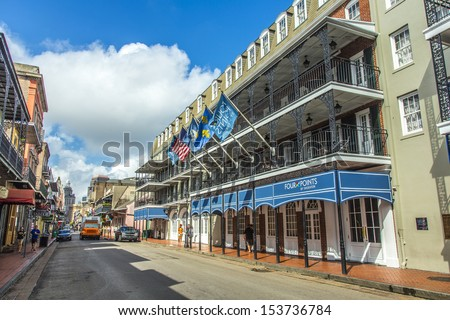 NEW ORLEANS, LOUISIANA USA - JULY 17: historic building in the French Quarter on July 17, 2013 in New Orleans, USA. Tourism provides a large source of revenue after the 2005 devastation of Hurricane Katrina. - stock photo