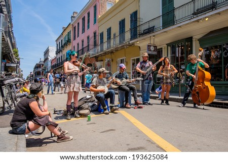 NEW ORLEANS, LOUISIANA USA - MAY 1, 2014: Unidentified street performers playing blue grass style music in the French Quarter district in New Orleans, Louisiana. - stock photo