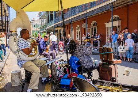 NEW ORLEANS, LOUISIANA USA - MAY 1, 2014: Unidentified street performers playing jazz style music in the French Quarter district in New Orleans, Louisiana. - stock photo