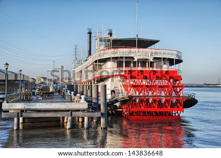 NEW ORLEANS - MAR 11: Riverboat Natchez docked in Mississippi River at New Orleans, on March 11, 2010. The steam paddle wheeler is a classic expression of the best of America's steamboat tradition. - stock photo