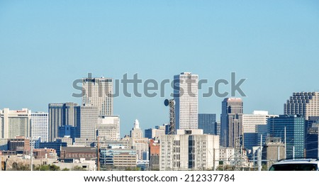 NEW ORLEANS - MARCH 6, 2009: City skyline on a beautiful sunny day. Almost 9 million people visit New Orleans every year.