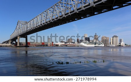NEW ORLEANS - MARCH 28: The skyline of the city of New Orleans, Louisiana as viewed under the Crescent City Connection on March 28, 2015. New Orleans is the largest city in Louisiana. - stock photo