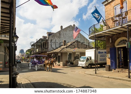 NEW ORLEANS - Oct 13: Mule-Drawn Carriage in the city streets, October 13, 2012 in New Orleans. Going on a carriage is very popular among tourists  - stock photo