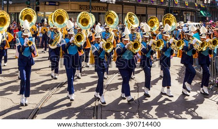 NEW ORLEANS USA FEB 1 2016: Mardi Gras parades through the streets of New Orleans. People celebrated crazily. Mardi Gras is the biggest celebration the city of New Orleans hosts every year.  - stock photo