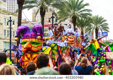 NEW ORLEANS USA FEB 1 2016: Mardi Gras parades through the streets of New Orleans.People celebrated crazily. Mardi Gras is the biggest celebration the city of New Orleans hosts every year.  - stock photo
