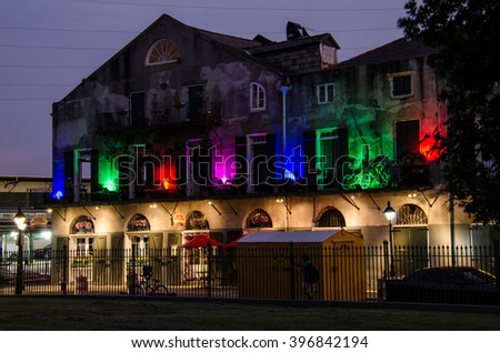 New Orleans, USA - July 13, 2015: Multicolored lights building with Louisiana Pizza Kitchen restaurant in French Quarter, New Orleans. - stock photo