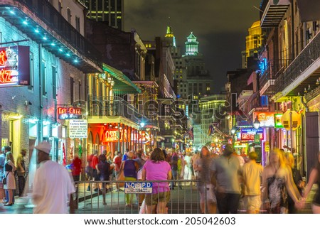 NEW ORLEANS, USA - JULY 14, 2013: Neon lights in the French Quarter in New Orleans, USA. Tourism provides a much needed source of revenue after the 2005 devastation of Hurricane Katrina.