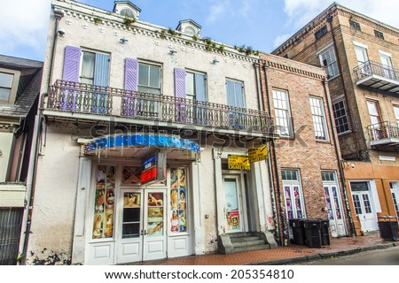 NEW ORLEANS, USA - JULY 17, 2013: sex shops in historic building in the French Quarter in New Orleans, USA. Tourism provides a large source of revenue after the 2005 devastation of Hurricane Katrina. - stock photo