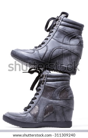 New pair of gray Sneakers arranged on one another (stitched in Uzbekistan) - stock photo