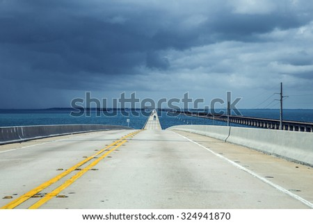 new part of the seven miles bridge under cloudy sky - stock photo
