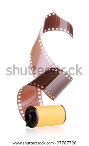 New photo film in cartridge isolated on white - stock photo