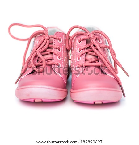 new pink shoes for a baby white background