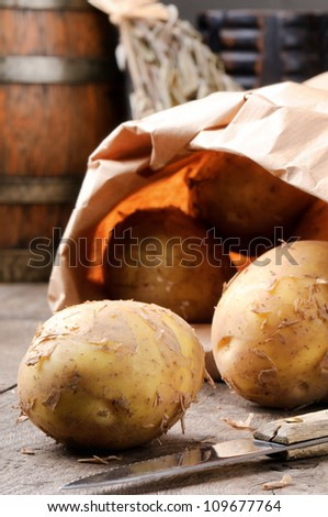 New potatoes in a brown paper bag - stock photo