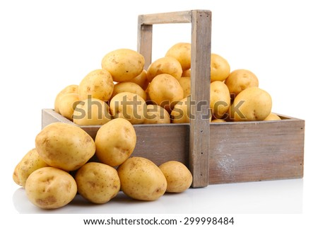 New potatoes in wooden table isolated on white - stock photo