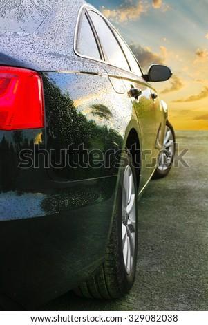 new prestigious dark car on sunset - stock photo