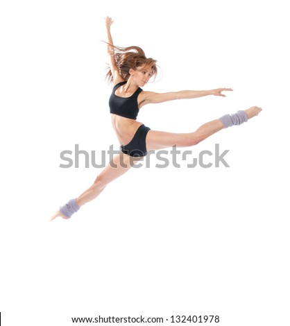 New pretty modern slim stylish teenage girl jumping dancing isolated on a white studio background - stock photo