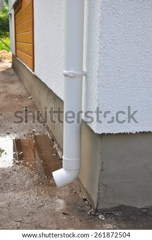 New rain gutter on house construction - stock photo