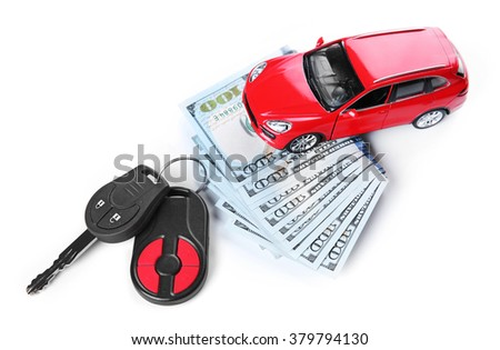 New red car with keys and dollar banknotes, isolated on white - stock photo