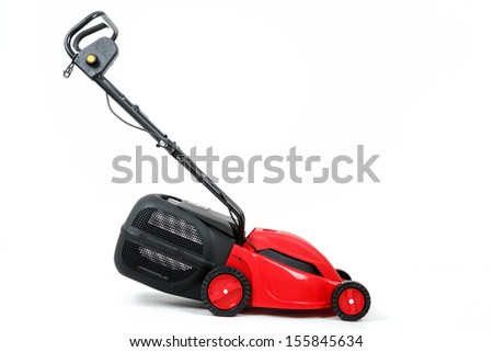 new red lawnmower isolated on white, studio shoot