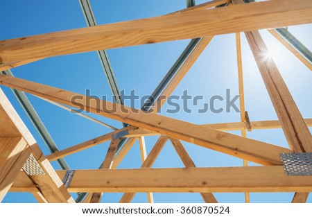 New residential construction home framing against a sunny sky.Local focus - stock photo
