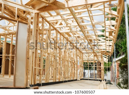 New residential construction home wooden framing against a blue sky