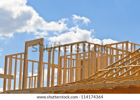 New residential construction house framing against a blue sky. Door to your dream home. - stock photo