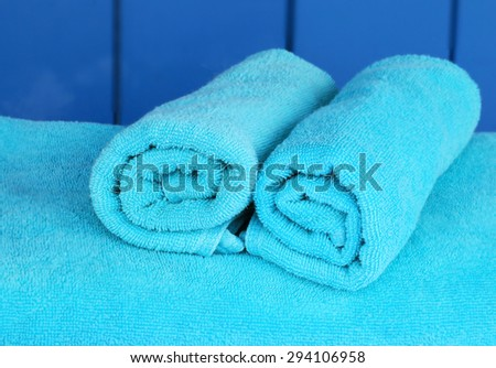 New rolled up white cloth beach towels.  - stock photo