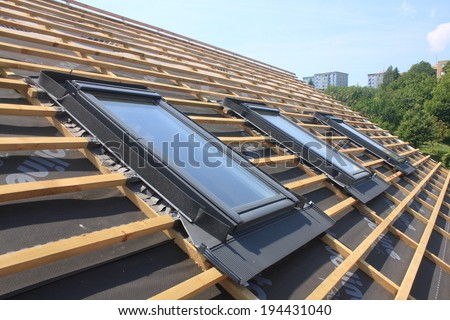 New roof coverings but without the skylights -  roof windows - stock photo