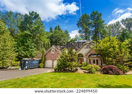 New roofing partially complete on suburban home - stock photo