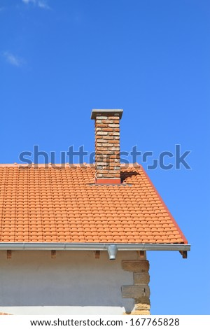 New rooftop and chimney under blue sky