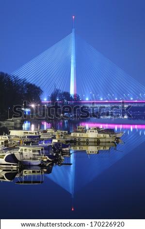 New Sava Bridge, Blue cast , Belgrade, Serbia, by night, long exposure - stock photo