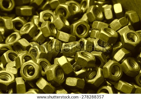 new screw nut piled up together, closeup of photo