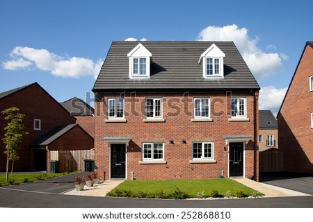 New semi - detached house in sunny day - stock photo