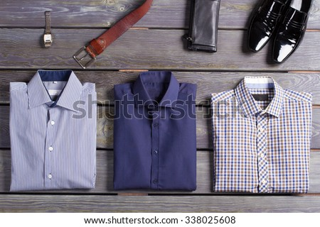 New shirts and accessories on a beautiful background. Top branded men's clothing. - stock photo