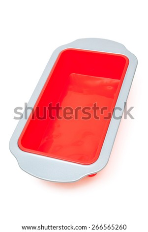 new silicone baking mould on a white background - stock photo