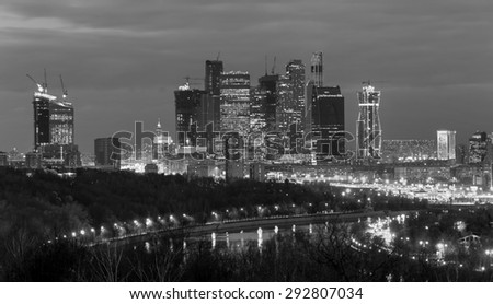 New skyscrapers business center in Moscow at night, Russia (black and white) - stock photo