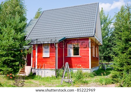 new small country house in summer day - stock photo