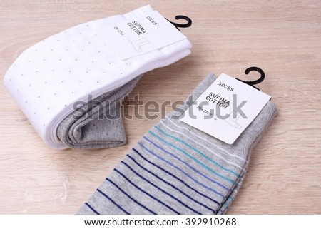New socks on wooden background